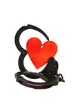 Handcuffs and heart Stock Images