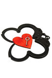 Handcuffs and heart Stock Photography