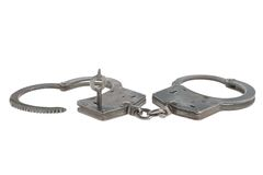Handcuffs in heart shape and key within isolated Royalty Free Stock Image