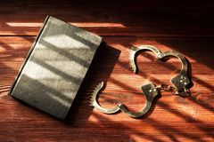 Handcuffs and the Holy Bible. Concept Picture of Someone Who Rel stock photo