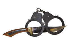 Handcuffs and hunting knife Stock Image
