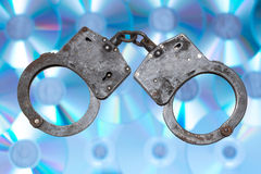 Handcuffs internet piracy concept Royalty Free Stock Images