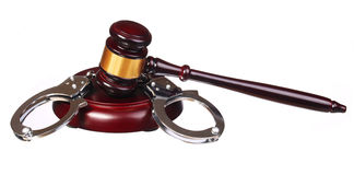 Handcuffs and Judge Gavel isolated Stock Photos