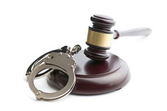 Handcuffs and judge gavel Royalty Free Stock Photos