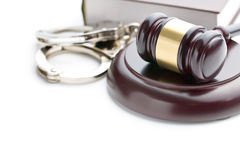 Handcuffs and judge gavel. On white background Royalty Free Stock Images