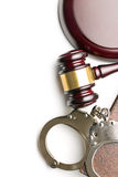 Handcuffs and judge gavel Stock Photography