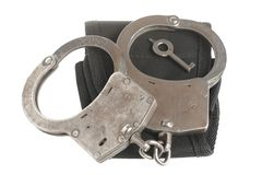 Handcuffs with key and �ase on white. Handcuffs with key and case on white background Stock Photo