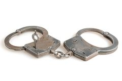Handcuffs with a key within on white. Background Royalty Free Stock Image