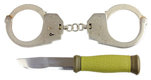 Handcuffs and a knife Royalty Free Stock Photo