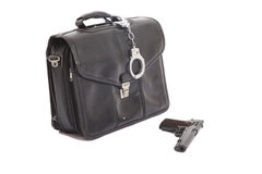 Handcuffs a leather case and a gun Stock Photos