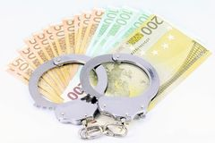 Handcuffs and money Royalty Free Stock Image