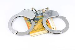 Handcuffs and money Stock Images