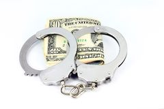 Handcuffs and money Royalty Free Stock Photos