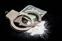 Handcuffs, money and drugs on black background Royalty Free Stock Photos