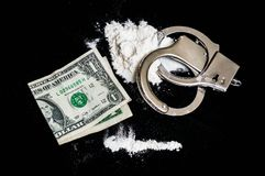 Handcuffs, money and drugs on black background Royalty Free Stock Photography