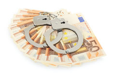 Handcuffs on money Stock Photography