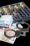 Handcuffs and money Stock Photos