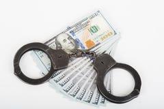 Handcuffs, money and gun. Stock Photos
