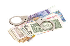Handcuffs and money i Stock Images