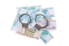 Handcuffs and money isolated Royalty Free Stock Images