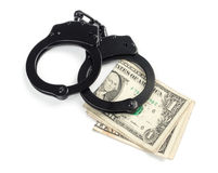 Handcuffs on money Stock Images