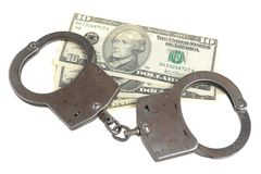 Handcuffs and money isolated on white background Stock Image