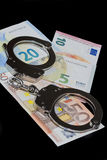Handcuffs and money Royalty Free Stock Photo