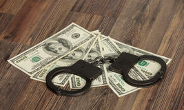 Handcuffs and money Stock Photography