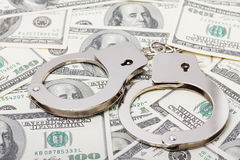 Handcuffs on money Stock Photos