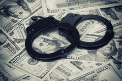 Handcuffs on money Royalty Free Stock Photos