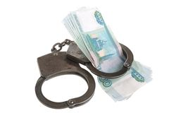 Handcuffs and money on white background. Handcuffs and money isolated on white Stock Photo