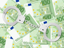 Handcuffs on one hundred euro background Stock Image