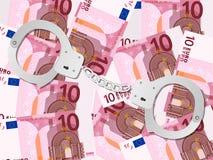 Handcuffs op euro achtergrond tien Royalty-vrije Stock Fotografie