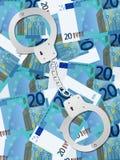 Handcuffs op euro achtergrond twintig Royalty-vrije Stock Afbeeldingen