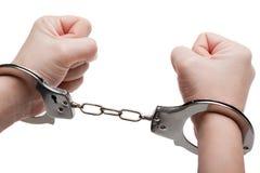 Handcuffs op handen Stock Fotografie