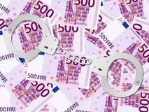 Handcuffs op vijf honderd euro achtergrond Royalty-vrije Stock Afbeeldingen