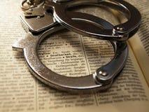 Handcuffs op woordenboek Royalty-vrije Stock Afbeelding