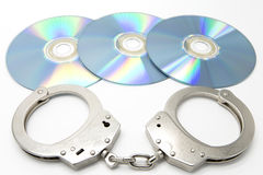 Handcuffs and optical discs Stock Image