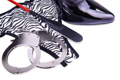 Handcuffs and panties. Isolated on white background Royalty Free Stock Photos