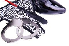 Handcuffs and panties Royalty Free Stock Photos