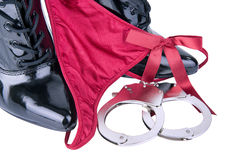 Handcuffs and panties Royalty Free Stock Photography