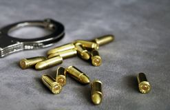 Handcuffs, pistol bullets and ID holder for cops, special forces and defense units equipment royalty free stock photos