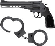 Handcuffs and pistol Stock Photography