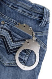 Handcuffs in the pocket. Of a blue jeans Royalty Free Stock Photo