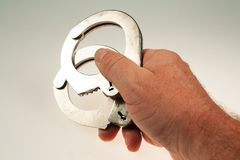 Handcuffs. Police handcuffs to prevent movement of the hand Royalty Free Stock Photo