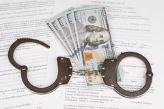 Handcuffs and purchase agreement Royalty Free Stock Photo