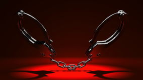 Handcuffs. On Red Background