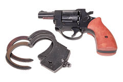 Handcuffs and revolver Stock Photo