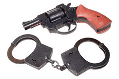 Handcuffs and revolver Stock Photography