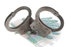 Handcuffs and russian money. Handcuffs on russian money Stock Photography